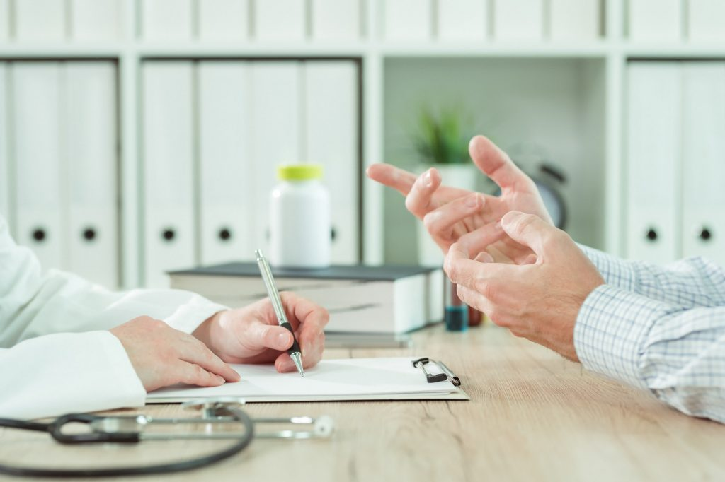 Doctor and patient during consultation in medical office
